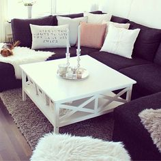 My fav so far. Your black sofa would look lovely with white furniture and a grey floor, which doesnt get so messy like a lighter one.