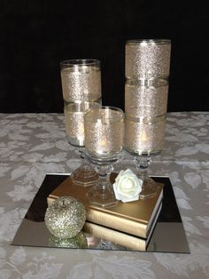 Fairy tale inspired centerpiece. Gold apple, book and candles.