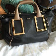 Chloe Ethel Handbag. Nwot Gorgeous black bag with gold and tan accents. Never carried. Comes with detachable shoulder strap and dust bag. Chloe Bags Satchels