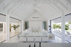 Pitched ceiling pavilion with large openings to the garden and other spaces.