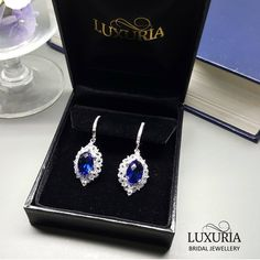High quality bridesmaid jewelry gift set.  Pair of 925 Sterling silver earrings decorated with diamond simulants packed in a black jewellery box as shown.   Global shipping.