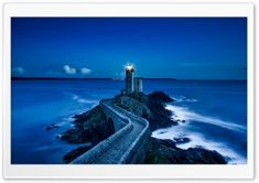 Lighthouse On Coastline Picture. Exterior of lighthouse at end of winding path along rocky coastline illuminated at twilight. Free Pictures, Free Images, Pictures Images, Ocean Pictures, Hd Images, Voyager Loin, Lighthouse Art, Lighthouse Pictures, Lighthouse Keeper