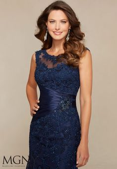 Evening Gowns and Mother of the Bride Dresses by Morilee. Beaded Lace Appliqués on Net Trimmed with Satin Evening Gown