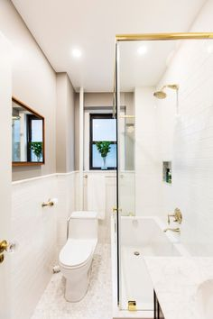A prewar NYC bathroom restores its beauty with classic subway tiles, marble floors and gold fixtures 💛 Renovating on a budget? Get this look using Walmart's home remodeling collection. Bathroom Renovations, Home Remodeling, Bathrooms, Upper West Side Apartment, Lighted Medicine Cabinet, Walmart Home, Shower Fixtures, Marble Floor, Plumbing Fixtures