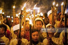 Children carry torches during a procession to celebrate the beginning of the holy month of Ramadan on June 27, 2014 in Jakarta, Indonesia. Ramadan, the ninth month of the Islamic calendar, is observed by Muslims with fasting, prayers and recitation of the Quran.
