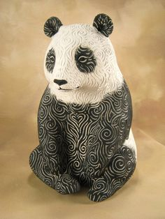 Sara M. Panda Ceramic Sculpture by AnimalsbyLaurie on Etsy.( I think the panda's texture looks cool and creative and I love pandas)