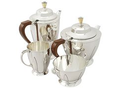 A fine and impressive antique George V English sterling silver four piece tea and coffee service in the Art Deco style.