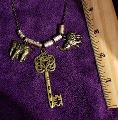 Necklace old brass key and elephants by KudzuCatCreations on Etsy