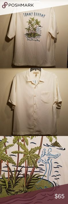 🌴Men's Tommy Bahama 💯% silk embroidered shirt Ivory button-down camp shirt. 100% silk, excellent condition. No missing buttons, pics, pull or stains. Additional buttons are still attached. Embroidery in excellent condition no missing stitches. This beauty is vacation ready! Laying flat it measures 20 inches across top of shoulders, 24 inches across chest and length is 28 inches. Colors may appear differently in person than on digital devices. Tommy Bahama Shirts Casual Button Down Shirts