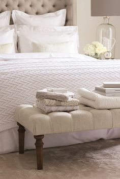 handy end of bed ottoman - best place for extra guest towels