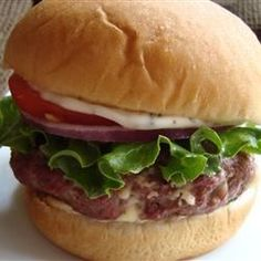 These hamburger patties are made with ground beef combined with blue cheese, Worcestershire sauce, and dry mustard. Grill or broil for best flavor.