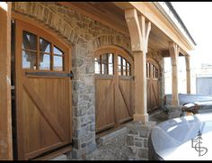 Beautifully Arched Cascade Style Doors http://www.evergreencarriagedoors.com