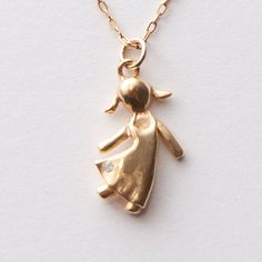 Child Pendant, 14K Gold and Diamond Pendant, girl gold diamond pendant, mother's necklace, father's pendant, baby pendant. $175.00, via Etsy.