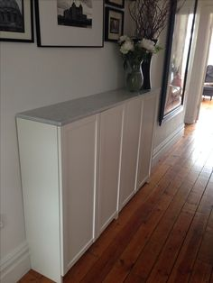 Ikea Billy bookcases for hallway shoe storage, topped with marble