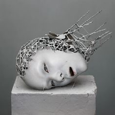 yuichi ikehata's digitally distored hybrid humans are sculpted with wire and paper