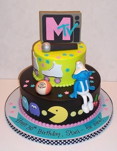 Totally 80's Cake - Remember the 80's?  Neon colors, hacky sacks, Smurfs and Pac-Man?  MTV, roller rinks and Valley Girl talk?  This cake was a fun one to make - I had my own little trip down memory lane!  All buttercream icing with fondant and gum paste decorations.