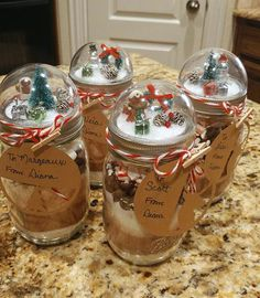 Snow Globe Mason Jar Gifts with a peppermint hot cocoa recipe for a pint size jar.