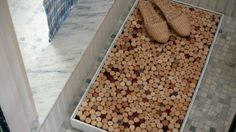 More ideas for all those corks you have been saving. Glue in place inside wood frame for shower mat.