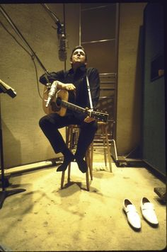 I love this shot of Johnny Cash in the recording studio sans shoes :)
