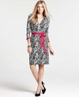 """Paper Mache Print 3/4 Sleeve Wrap Dress - Cut in a silhouette-slimming wrap style, this knit jersey dress boasts gorgeous graphics in high-impact black and white, popped with pink for a statement making finish. V-neck with crossover front. 3/4 sleeves with cuff slits. Self waist tie. 22"""" from natural waist."""