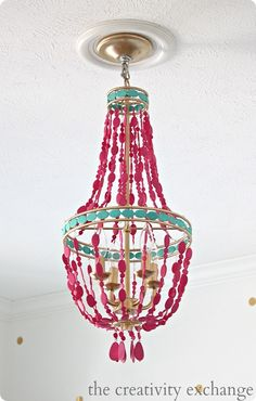 I am loving this BOLD designer-inspired chandelier makeover with hot pink and aqua painted beads! Chandelier Makeover, Beaded Chandelier, Painted Chandelier, Shell Chandelier, Turquoise Chandelier, Chandelier Lighting, Origami Lamps, Chandeliers, Painting Hardware