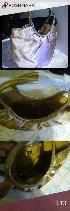 Avon little handbag color: Goldtone Brand new handbag material: 100% polyester/ PVC trim Avon Bags Mini Bags