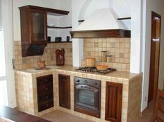 Angolo cottura in muratura - Piccolo, compatto e funzionale, l'angolo cottura in muratura e legno