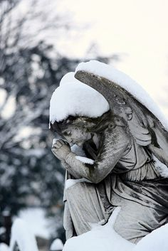 Praying angel in the snow    at Mount Jerome cemetery, Dublin