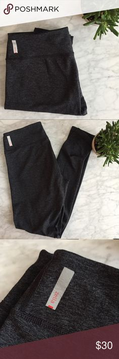 "Zella Live In Leggings Full length Zella ""Live In"" leggings in gray. Overall in very good used condition with minimal pilling, but the reflective Zella logo has some cracking. These are original rise, not high rise. No trades, but offers welcome! Zella Pants Leggings"