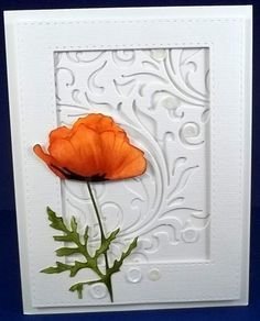 I found a card on pinterest that used this swirl die from tim holtz.. of course I just had to have it..  I think it really makes a unique background for this single poppy.  add a few sequins for the finishing touch. I colored the poppy with sponges.  Love seeing all the beautiful flowers in the gallery today!