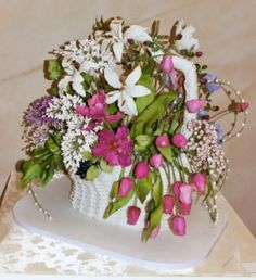 The Wedding Basket speaks to an era when wedding guests walked together to the site of the ceremony gathering flowers along their way as a gift for the couple.  This old European tradition gave rise to the creation of a wedding basket and was the inspiration for this creation.