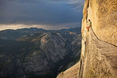 Half Dome, Yosemite National Park, USA  Rock climber Alex Honnold sits on a ledge on the Northwest Face of Half Dome in Yosemite National Park.