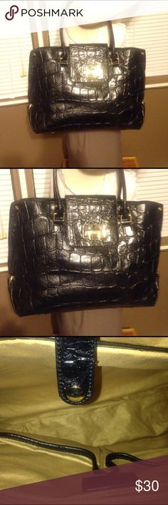 Large Cow Leather Antonio Melani Bag Black. Used in excellent condition. Signs of wear are a few pen marks in interior shown in pic. Other than that it's in excellent condition. Inside has two large compartments large enough to fit laptop. Tons of space. Beautiful bag ANTONIO MELANI Bags Totes