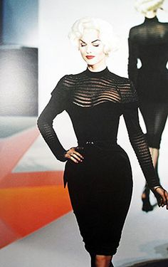 Collectors!  Thierry Mugler Iconic Siren Dress in Book | From a collection of rare vintage evening dresses at https://www.1stdibs.com/fashion/clothing/evening-dresses/