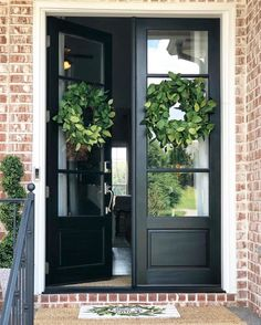 We added some simple wreaths to our client's gorgeous double doors, along with a single topiary and layered… Double Door Wreaths, Double Front Entry Doors, Double Doors Exterior, Black Front Doors, Front Door Entrance, Door Entryway, Front Door Decor, Farmhouse Front Doors, Wood Front Doors