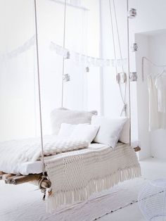 Rustic Master Bedroom with Concrete floors, High ceiling, Suspended rope bed, Antique Silver Faceted Hanging Votive Holder