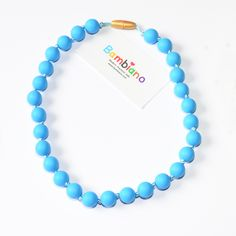 Bambiano Nicole Jr Necklace in Deep Sea Blue. Bambiano Jr Necklaces are made of 100% Food grade silicone. BPA free, Lead free and nontoxic. Fashionable for trendy girls 3 years and above. Necklaces are colourful, washable and soft against the skin. Shop at www.bambiano.com