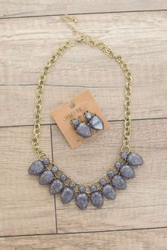 Shop our Sparkle Stone Statement Necklace - Midnight Purple. Free shipping on all US orders!