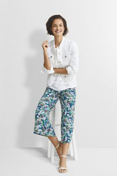 8e8e7c4b389cd1 These flowy cropped pants are accented with a gorgeous floral pattern for a  beautifully bold look