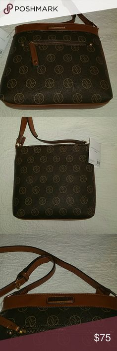 NWT Adrienne Vittadini Signature Brown Crossbody Adrienne Vittadini crossbody bag, dark brown with reddish brown details and straps, new with tags. It boasts an adjustable strap, a zippered main compartment, two zippered pockets: one inside, one outside, and an interior open pocket. 10 inches long, 9 inches high, 2 inches deep. Classy leather look polyurethane with the AV logo. Contact me with any questions or offers and happy shopping! Adrienne Vittadini Bags Crossbody Bags
