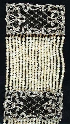 A Belle Epoque seed pearl and diamond collier de chien, circa 1900. Composed of eighteen rows of seed pearls connected by three rose-cut diamond rectangular openwork plaques of lattice and elaborate foliate scrolls, each with removable grosgrain inserts, maker's mark to clasp. #BelleÉpoque #Choker