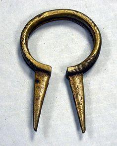 Bracelet Date: 19th–20th century Geography: Burkina Faso Culture: Lobi Medium: Copper alloy Dimensions: H x W x D: 4 1/4 x 2 3/4 x 1/2in. (10.8 x 7 x 1.3cm)