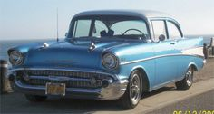 '57 chevy.  back when all the makes looked distinctlively different...and i knew every one.  (even though i was a girl!)