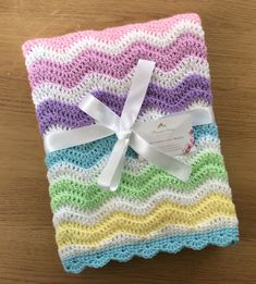Handmade Crochet rainbow ripple baby blanket - great baby shower gift, perfect size for a Moses basket or Buggy. Baby Shower Gift Basket, Baby Shower Favors, Baby Shower Gifts, Crochet Baby Blanket Sizes, Crochet Baby Boots, Baby Shower Table Decorations, Baby Shower Centerpieces, Baby Shower Themes Neutral, Diy Shower
