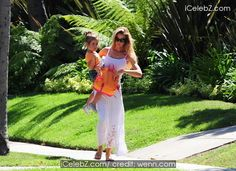 Denise Richards Denise Richards in a white see-through cotton maxi dress carries her daughter Eloise in her arms while out and about in West Hollywood http://www.icelebz.com/events/denise_richards_in_a_white_see-through_cotton_maxi_dress_carries_her_daughter_eloise_in_her_arms_while_out_and_about_in_west_hollywood/photo1.html
