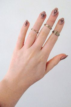 Let your inner witch show with these nail tattoos. And they are really stylish too! ................................................................................................................ WHA