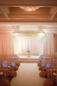 These flowers on top but simple straight draping on the four poles?