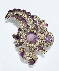 An 18th century amethyst and chrysoberyl aigrette  Of stylised feather and floral design, the central amethyst and chrysoberyl cluster with similarly set plume amd foliage, possibly Portuguese, in silver mounts with coloured foil backs, later brooch fitting
