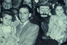 Frank Sinatra and Emmett Kelly at the circus (with their daughters)  http://famousclowns.org/famous-clowns/emmett-kelly-sr-biography-world-famous-tramp-clown/
