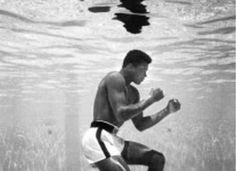 Muhammad Ali, then still Cassius Clay, training in a pool at the Sir John Hotel in Miami